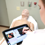 Student practicing with simulation education